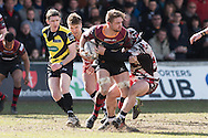 Lewis Evans of the Newport Gwent Dragons is stopped by WP Nel of Edinburgh rugby but he still manages to off load which leads to a try by Hallam Amos of the Newport Gwent Dragons. Guinness Pro12 rugby match, Newport Gwent Dragons v Edinburgh Rugby at Rodney Parade in Newport, South Wales on Sunday 27th March 2016.<br /> pic by  Simon Latham, Andrew Orchard sports photography.