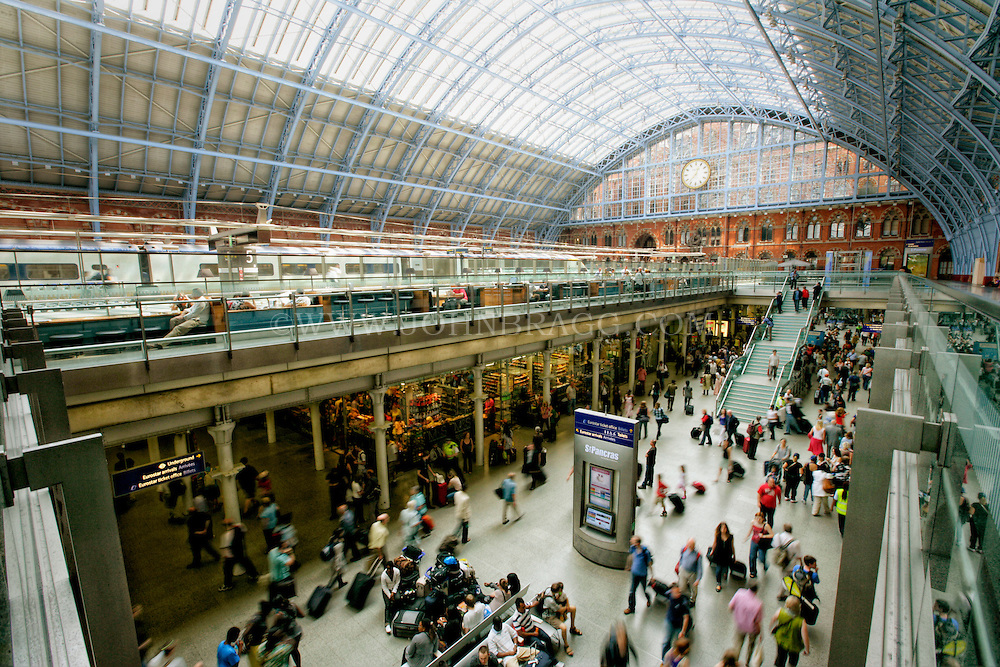 The St. Pancras Railway Station, The Station Clock in the foreground, London, England.