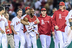 ANAHEIM, California/USA (Tuesday, September 26, 2012) - Los Angeles Angels outfielder Torii Hunter celebrates after  his 10th career walk-off hit, an RBI single that gave the Angels a 4-3 victory during the Mariners vs. Angels game held at the Angels Stadium.  Byline and/or web usage link must read PHOTO © Eduardo E. Silva/SILVEX.PHOTOSHELTER.COM.