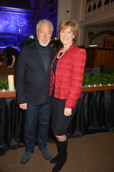 SIR TOM JONES and ANN CHALMERS Chief Executive of Child Bereavement UK at the charity Child Bereavement UK's 21st Anniversary Christmas Carol Concert held at Holy Trinity Brompton, London on 10th December 2015.