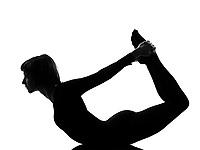woman urdhva dhanurasana upward bow pose yoga posture position in silouhette on studio white background