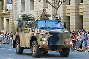 Australian Army Bushmaster Protected Mobility Vehicle army truck during Brisbane ANZAC day 2014 parade <br /> <br /> Editions:- Open Edition Print / Stock Image