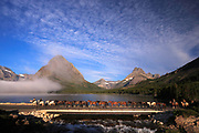 Horses make their way along the shore of Swiftcurrent Lake, Glacer National Park.