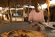 A trader sells meat in the market of Abyei.