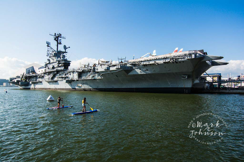 Stand-Up Paddle Boarding off the USS Intrepid, Hudson River, Manhattan, New York City, New York, USA