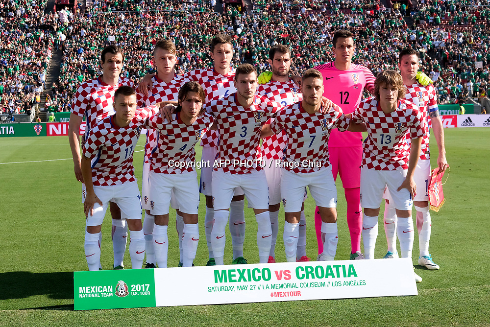 Croatia National team pose for photo before an international friendly soccer game against Mexico at LA Memorial Coliseum on May 27, 2017 in Los Angeles, California. Croatia won 2-1.  AFP PHOTO / Ringo Chiu