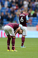 John Terry, the Aston Villa captain (l) slumps dejected at the end of the match after his team lose the match by three goals to nil.EFL Skybet championship match, Cardiff city v Aston Villa at the Cardiff City Stadium in Cardiff, South Wales on Saturday 12th August 2017.<br /> pic by Andrew Orchard, Andrew Orchard sports photography.