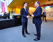 © Licensed to London News Pictures. 26/09/2011. LONDON, UK. Leader of the Labour Party, Ed Miliband (L) talks with Shadow Chancellor Ed Balls at the Labour Party Conference in Liverpool today (26/09/11). Photo credit:  Stephen Simpson/LNP