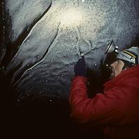 Glaciologist Jon Ove Hagen explores far into polar sub-glacial river cave.
