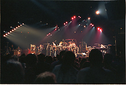 The Grateful Dead Live at The Capital Centre, Landover MD on the 16th of March 1990. Shot on the floor from Stage Left about 20 or so rows back. Wide with Fans, Lights and Band.