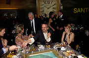 the president of Cartier Bernard Fornas, Jeremy irons, Party to celebrate 100 years of the Santos  de Cartier watch. Le Bourget airport. Paris. 7 April 2004. ONE TIME USE ONLY - DO NOT ARCHIVE  © Copyright Photograph by Dafydd Jones 66 Stockwell Park Rd. London SW9 0DA Tel 020 7733 0108 www.dafjones.com