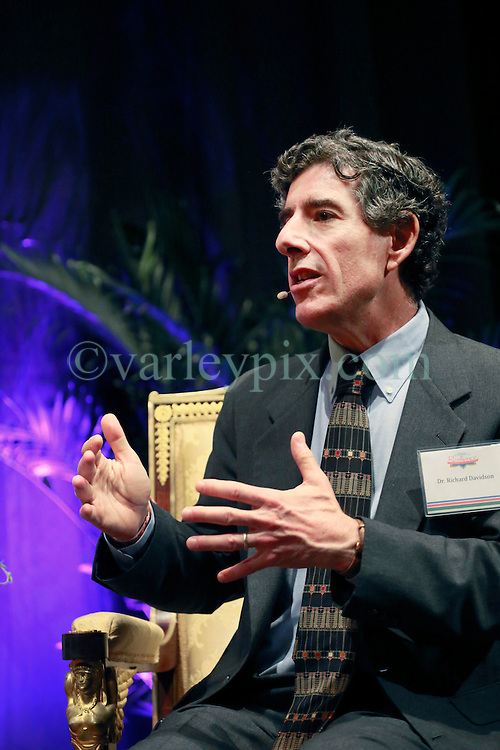 17 May 2013. New Orleans, Louisiana,  USA..Dr Richard Davidson of Tulane University speaks with His Holiness the 14th Dalai Lama in New Orleans for the 'Resiliance - Strength through Compassion and Connection' conference. .The Dalai Lama's shoes..Photo; Charlie Varley.