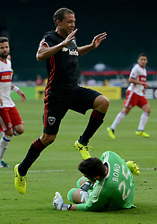 August 5, 2017 - Washington, DC, USA - 20170805 - D.C. United midfielder NICK DELEON (14) steps over Toronto FC goalkeeper ALEX BONO (25), after Bono covered the ball in the first half at RFK Stadium in Washington. (Credit Image: © Chuck Myers via ZUMA Wire)