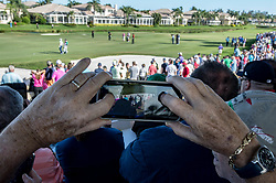 February 25, 2018 - Palm Beach Gardens, Florida, U.S. - Fans takes pictures of Tiger Woods on the 16th hole during the final round of the Honda Classic at PGA National Resort and Spa in Palm Beach Gardens, Florida on February 25, 2018. (Credit Image: © Allen Eyestone/The Palm Beach Post via ZUMA Wire)
