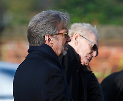 © London News Pictures. 05/11/2014. Cream Guitarist ERIC CLAPTON (left) and Cream drummer GINGER BAKER (right) arriving for the service. The funeral Jack Bruce at Golders Green Crematorium in North London. Jack Bruce was the lead singer and bass player for British Rock band Creme, alongside Eric Clapton and Ginger Baker. Creme sold over 15 million albums worldwide and were widely considered to be the worlds first successful supergroup. Photo credit : Ben Cawthra/LNP