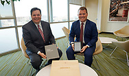 J.J. Ament (L), Metro Denver Economic Development Council (EDC) CEO and Sam Bailey, vice president of the Metro Denver EDC, pose with the paper and Kindle versions of Colorado's proposal for the Amazon.com Inc's $5 billion second headquarters at an event in Denver, Colorado U.S. November 16, 2017.  REUTERS/Rick Wilking