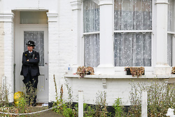 © Licensed to London News Pictures. 07/07/2019. London, UK. A police officer guards the entrance of at a house on Livingstone Road, Bounds Green in Enfield, North London where a woman and three girls were stabbed before noon on Saturday 6 July 2019. According to the Met Police, the condition of the woman, in her 30s, and two girls, both aged under 12 is now stable and non life-threatening after they were treated for serious stab wounds. The third victim aged 11, remains in a critical condition. A man has been arrested on suspicion of attempted murder. Photo credit: Dinendra Haria/LNP