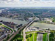 Nederland, Zuid-Holland, Dordrecht, 14-05-2020; Drechttunnel (A16) onder de Oude Maas en Spoorbrug Dordrecht  (Zwijndrechtse Brug bijgenaamd het Hemelbed). Zicht op binnenstad van Dordt met Grote Kerk of Onze-Lieve-Vrouwekerk.<br /> Drechttunnel (A16) under the Oude Maas and Dordrecht Railway Bridge (Zwijndrechtse Brug nicknamed the canopy bed). View of the inner city of Dordt with Grote Kerk or Onze-Lieve-Vrouwekerk.<br /> luchtfoto (toeslag op standard tarieven);<br /> aerial photo (additional fee required);<br /> copyright foto/photo Siebe Swart
