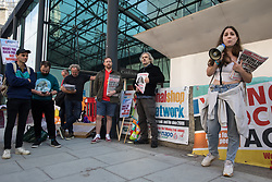 London, UK. 9th October, 2021. A speaker from Waltham Forest Socialist Party addresses Young Socialists and supporters outside the Department for Business, Energy and Industrial Strategy (BEIS) before a London March for Jobs. The march was organised by London Young Socialists and Youth Fight for Jobs, a youth organisation formed in 2009 in response to a rise in youth employment following the 2007-2008 financial crash, to call for decent jobs for young people, a £15ph minimum wage and an end to zero-hour contracts.