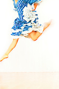 Dancer in blue polka dot dress jumping