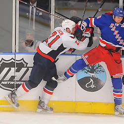 April 30, 2012: Washington Capitals center Brooks Laich (21) checks New York Rangers defenseman Marc Staal (18) during second period action in Game 2 of the NHL Eastern Conference Semifinals between the Washington Capitals and New York Rangers at Madison Square Garden in New York, N.Y.