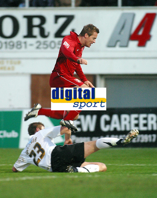 Photo: Dave Linney.<br />Hereford United v Walsall. Coca Cola League 2. 18/11/2006.Walsall's  Martin Butler(Top) evades a challenge from  Phil Gulliver.
