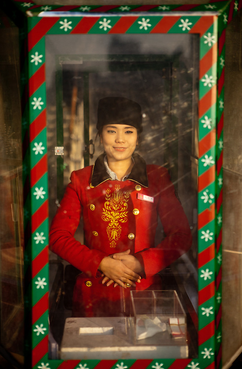 """Portrait of a female guard at the amusement park """"Woobang Tower Land"""" in Daegu. Daegu, also known as Taegu and officially the Daegu Metropolitan City, is the third largest metropolitan area in South Korea, and by city limits, the fourth largest city with over 2.5 million people. The IAAF World Championships in Athletics will take place in Daegu from the 27th of August till the 4th of September 2011."""