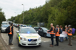 Insulate Britain climate activists blocking a slip road from the M25, causing a long tailback on the motorway, move aside to allow an ambulance to pass on 13th September 2021 in Godstone, United Kingdom. The activists, who wrote to Prime Minister Boris Johnson on 13th August, are demanding that the government immediately promises both to fully fund and ensure the insulation of all social housing in Britain by 2025 and to produce within four months a legally binding national plan to fully fund and ensure the full low-energy and low-carbon whole-house retrofit, with no externalised costs, of all homes in Britain by 2030 as part of a just transition to full decarbonisation of all parts of society and the economy.