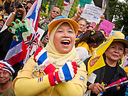"""22 JUNE 2011 - BANGKOK, THAILAND: A Thai Muslim woman who supports the Yellow Shirts calls for a no vote during a pre-election rally in Bangkok on Wednesday, June 22. The PAD (People's Alliance for Democracy) or Yellow Shirts, as they are popularly called, has called for a """"No"""" vote in Thailand's national election, scheduled for July 3. PAD leadership hopes the no vote will negate the vote of Yingluck Shinawatra, leader of the Pheua Thai party. Yingluck is the youngest sister of exiled former Prime Minister Thaksin Shinawatra, deposed by a military coup in 2006. Yingluck is currently leading in opinion polls, running well ahead of incumbent Prime Minister Abhisit Vejjajiva, head of the Democrat party, which in one form or another has ruled Thailand for most of the last 60 years.     Photo by Jack Kurtz"""