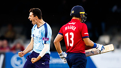 Yorkshire's Matt Fisher (left) celebrates taking the final wicket of the match to win the game after bowling Essex's Neil Wagner for 35 during the One Day Cup, Quarter Final at the Cloudfm County Ground, Essex.
