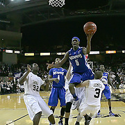 Memphis guard Will Barton (5) leaps over Central Florida guard A.J. Rompza (3) during a Conference USA NCAA basketball game between the Memphis Tigers and the Central Florida Knights at the UCF Arena on February 9, 2011 in Orlando, Florida. Memphis won the game 63-62. (AP Photo: Alex Menendez)