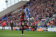 Queens Park Rangers Danny Simpson jumps for the ball with Wigan Athletic's Jean Beausejour. Skybet football league championship play off semi final, 1st leg match, Wigan Athletic v QPR at the DW Stadium in Wigan, England on Friday 9th May 2014.<br /> pic by Chris Stading, Andrew Orchard sports photography.