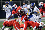 Henderson's Avery henderson pushed through the defense during their 3A game against Chapel Hill at Cowboys Stadium.