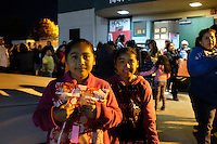 Twins Dani and Gabi Sixto were happy to attend the Christmas toy giveaway on Friday, made possible by the César Chávez Futbol Academy and the Alisal Family Resource Center on Friday.