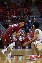 26 November 2016:  D.J.McCall defended by Madison Williams(25) during an NCAA  mens basketball game between the IUPUI Jaguars the Illinois State Redbirds in a non-conference game at Redbird Arena, Normal IL