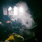 Preparing food for the mules before departing. Life at Mr and Ms Wangchuk's house on the edge of the Laya village.
