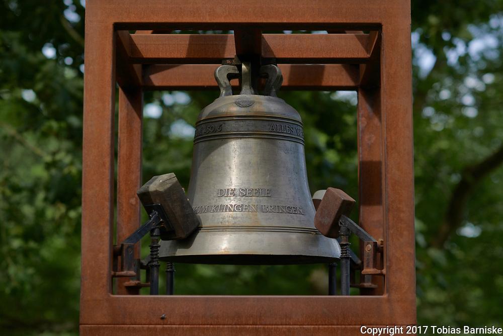 "At the world reformation exhibition: church bell bearing a inscription ""Die Seele zum klingen bringen"" (Let your soul make a sound)."