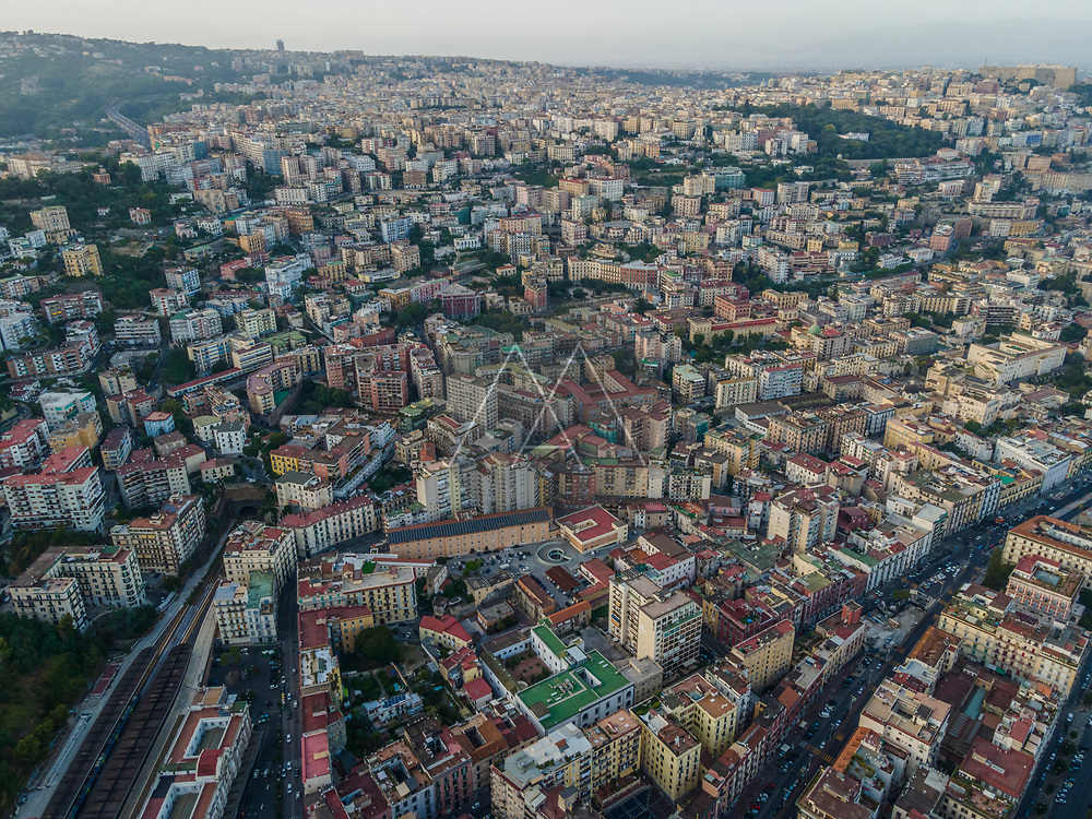 Aerial view of Naples downtown at sunset, view of the high density residential area on hillside, Naples, Italy.