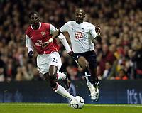 Photo: Olly Greenwood.<br />Arsenal v Tottenham Hotspur. Carling Cup Semi Final 2nd leg 31/01/2007. Spurs Didier Zokora and Arsenal's Emmanuel Adebayor