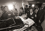 On March 6, 1978, during a legal battle related to obscenity in Gwinnett County, Georgia, Hustler Magazine publisher Larry Flynt and his local lawyer, Gene Reeves, Jr., were returning to the courthouse when they were shot on the sidewalk in front of 136 South Perry Street in Lawrenceville by a sniper standing near an alley across the street. The shooting left Flynt partially paralyzed with permanent spinal cord damage, and in need of a wheelchair. Flynt's injuries caused him constant, excruciating pain, and he was addicted to painkillers until multiple surgeries deadened the affected nerves. He also suffered a stroke caused by one of several overdoses of his analgesic medications. He recovered but has had pronunciation difficulties since.