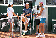 Winners of the 2020 French Open Iga Swiatek of Poland and Rafael Nadal of Spain practice together 20 minutes on Court 5 - here with Carlos Moya, coach of Rafael Nadal (center) - ahead of the French Open 2021, a Grand Slam tennis tournament at Roland-Garros stadium on May 29, 2021 in Paris, France - Photo Jean Catuffe / ProSportsImages / DPPI