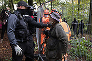 National Eviction Team bailiffs working on behalf of HS2 Ltd try to move an elderly photographer away from a fence being constructed during evictions from a wildlife protection camp in the ancient woodland which inspired Roald Dahl's Fantastic Mr Fox at Jones' Hill Wood on 1 October 2020 in Aylesbury Vale, United Kingdom. Around 40 environmental activists and local residents, some of whom living in makeshift tree houses 60 feet above the ground, were present during the evictions at Jones' Hill Wood which had served as one of several protest camps set up along the route of the £106bn HS2 high-speed rail link in order to resist the controversial infrastructure project.