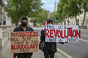 Black Lives Matter supporters holds a placard nearby Downing Street after protests in London, Friday, June 12, 2020. Anger against systemic levels of institutional racism has raged through the city, and worldwide; sparked following the death of George Floyd in the United States on May 25, 2020. (Photo/ Vudi Xhymshiti)
