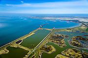 Nederland, Zeeland, Gemeente Schouwen-Duiveland, 01-04-2016; Prunjepolder, inlagen en Oosterschelde, Oosterscheldekering in de achtergrond. Plan Tureluur, het uitgestrekte zout/brakke kleimoeras in de polder is hersteld en 'teruggegeven aan de natuur'. Deze natuurcompensatie is aangelegd omdat er door de Deltawerken veel buitendijks getijgebied verloren was gegaan.<br /> The expansive salt / brackish marsh clay in the polder has been restored and given back to nature. This 'environmental compensation' must compensate for tidal area that were lost due to the Delta Works.<br /> <br /> luchtfoto (toeslag op standard tarieven);<br /> aerial photo (additional fee required);<br /> copyright foto/photo Siebe Swart