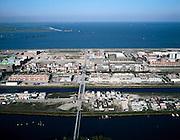 Nederland, Amsterdam, IJburg, 17-10-2005; luchtfoto (25% toeslag); de verschillende eilanden van de nieuwbouwwijk met de (gedeeltelijk) voltooide bouwblokken; de witte vlek links aan de horizon is een nieuw eiland in het IJmeer (zogenaamde compensatie ter vervanging van 'verloren gegane natuurwaarden'), beleid als gevolg van MER (milieu effect reportage); woningbouw, woningnoot, infrastructuur, bouwen, planologie, ruimtelijke ordening, landschap.Foto Siebe Swart