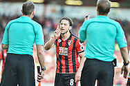 AFC Bournemouth Midfielder, Harry Arter (8) feels he was elbowed in the face by Tottenham Hotspur Midfielder, Moussa Sissoko (17) during the Premier League match between Bournemouth and Tottenham Hotspur at the Vitality Stadium, Bournemouth, England on 22 October 2016. Photo by Adam Rivers.