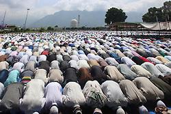 June 16, 2018 - Srinagar, Jammu and Kashmir, India - Thousands of Muslims offering Eid prayers at Dargah Srinagar. Eid is a festival Muslims celebrate the Eid Al-Fitr 1439 Hijri (Islamic Calendar) Day Ramadhan (Credit Image: © Arfath Naseer/Pacific Press via ZUMA Wire)