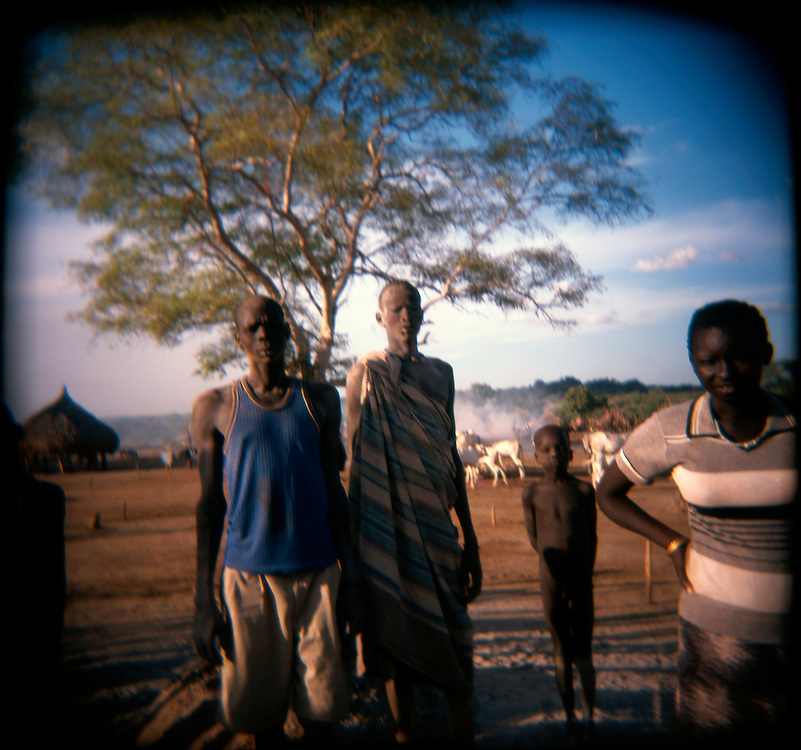 Mundari herdsmen at a cattle camp in Central Equatoria Province. The tribe suffered from inter-tribal conflicts and cattle russling in the northern part of the province, so they moved further south looking for safer grazing land..Kuruki, South Sudan. 12/10/2009..Photo © J.B. Russell