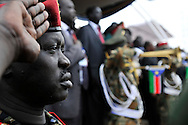 An SPLA officer saluting the new flag of the Republic of South Sudan as it is raised at the official independence day ceremony. After decades of conflict, Southern Sudan declared independence from the North on July 9th, 2011. Government officials, foreign dignitaries and ordinary people came to the John Garang Memorial in the capital from all over the country and the world to celebrate the historic occation..Juba, South Sudan. 09/07/2011..Photo © J.B. Russell