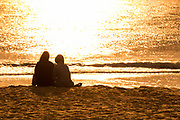 Couple Watching the Sunset on the Sand in Laguna Beach